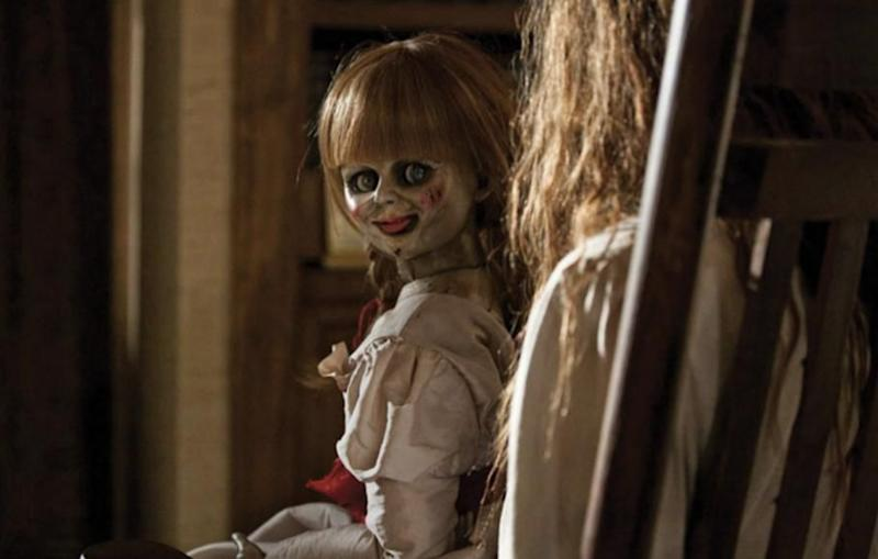 A UK-based woman has is being 'haunted' by her own Annabelle-style doll which is 100-years-old. Source: New Line Cinema