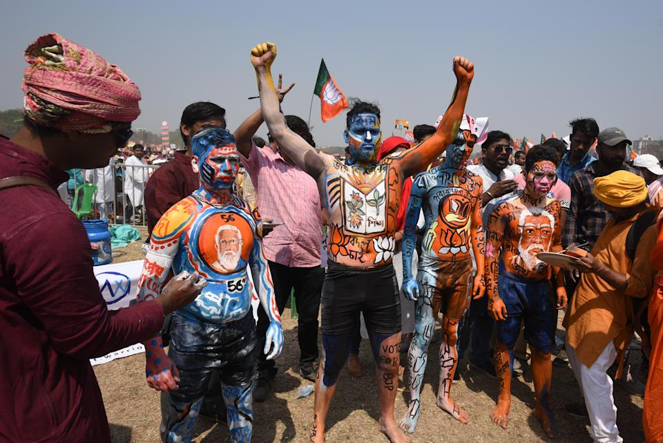 Bharatiya Janata Party (BJP) supporters in body paint at a public rally by Prime Minister Narendra Modi being held at Brigade Parade Ground on March 7, 2021 in Kolkata, India. (Photo by Samir Jana/Hindustan Times via Getty Images)