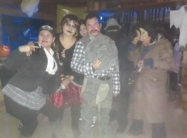 Danny Klondike, centre, holding a cowboy hat, at a Halloween party the night he died.