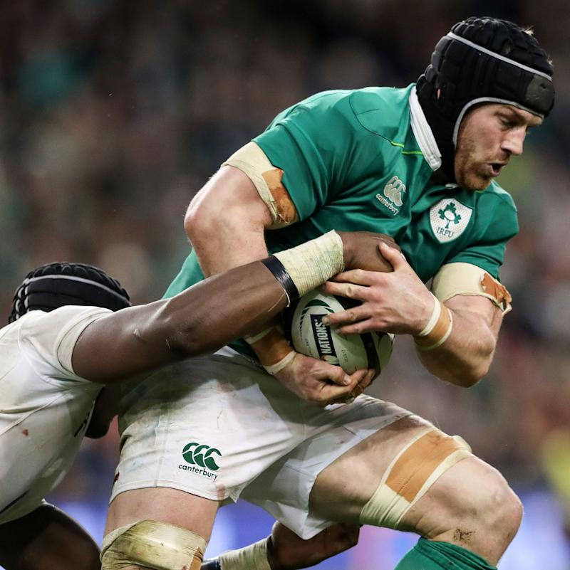Ireland's Sean O'Brien tackled by Maro Itoje - Credit: REX