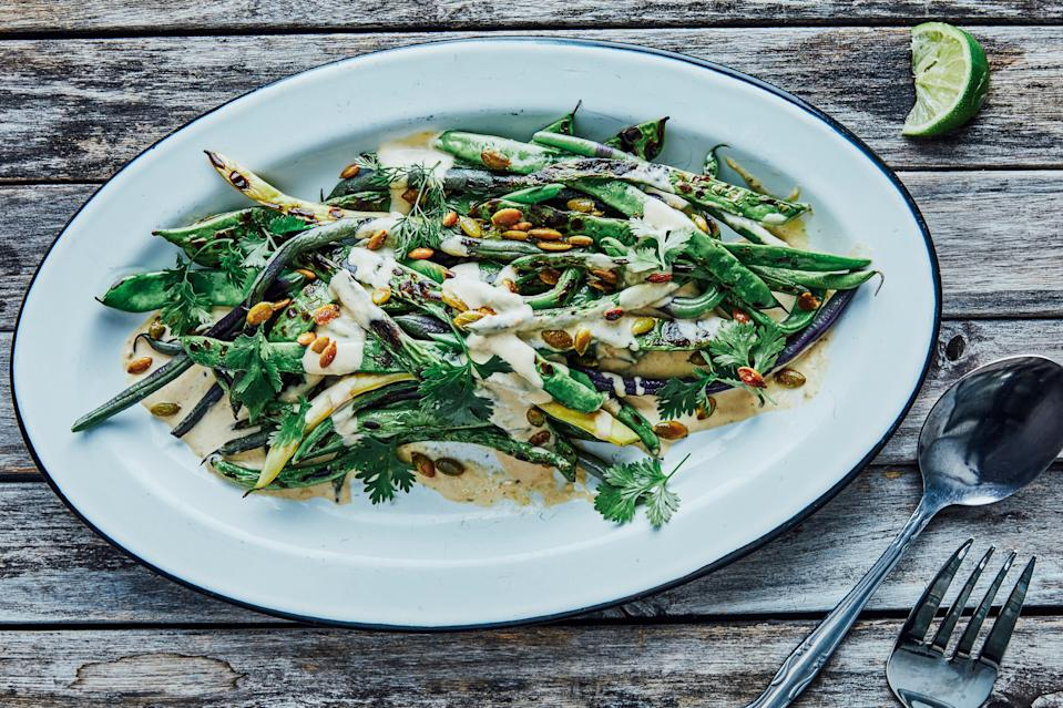 "The tonnato (a classic, creamy Italian sauce made with tuna and anchovies that's usually served with veal) gives these charred beans a strong umami base, while the lime and habanero chiles add brightness and a little heat. <a href=""https://www.bonappetit.com/recipe/charred-green-beans-with-spicy-tonnato?mbid=synd_yahoo_rss"" rel=""nofollow noopener"" target=""_blank"" data-ylk=""slk:See recipe."" class=""link rapid-noclick-resp"">See recipe.</a>"