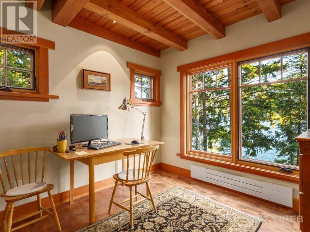 <p><span>3905 #407-3676 Horne Lake Caves Rd., Qualicum Beach, B.C.</span><br> You'll find rustic touches throughout including a timber frame with nine-foot ceilings, custom-built cabinetry, alder flooring and solid fir doors.<br> (Photo: Zoocasa) </p>