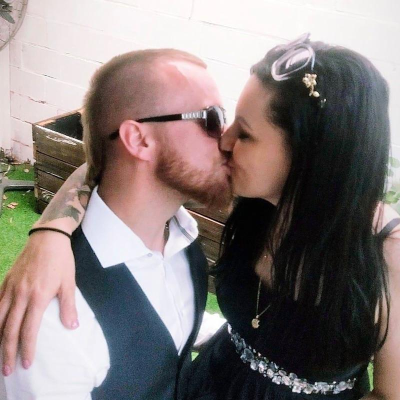 A picture of couple Kylie Galende and Jonnie Hartshorn kissing.