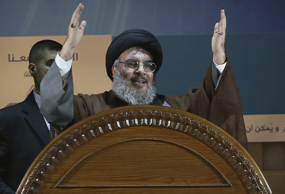 FILE - In this Aug. 2, 2013, file photo, Hezbollah leader Sheikh Hassan Nasrallah speaks during a rally to mark Jerusalem day or Al-Quds day, in a southern suburb of Beirut, Lebanon. On Saturday, Jan. 26, 2019, the head of Lebanon's Hezbollah group is warning Israel of widening its attacks in Syria because a miscalculation can drag the region into a war. (AP Photo/Hussein Malla, File)