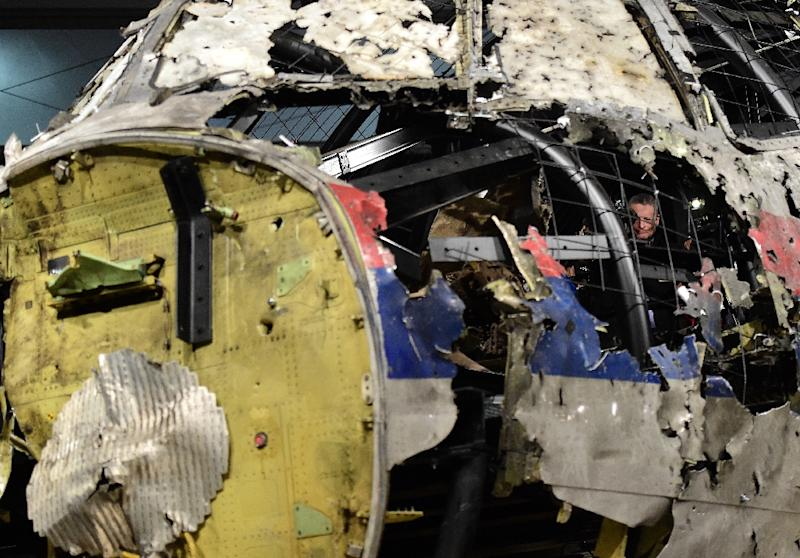 The wrecked cockpit of the Malaysia Airlines flight MH17 is shown to the press during a presentation of the final report on the cause of its crash at the Gilze Rijen airbase in the Netherlands on October 13, 2015