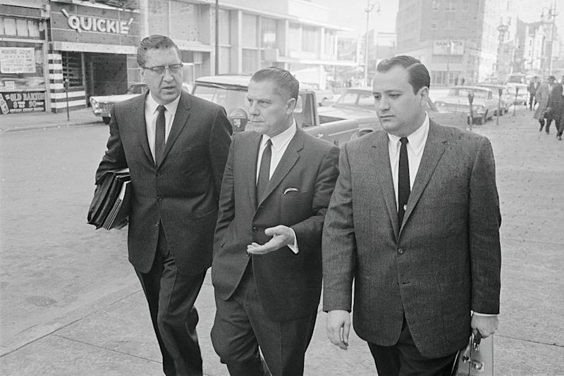 Jimmy Hoffa (center) with his attorney William Bufalino (left) and an aide, leaving federal court after Hoffa was convicted of jury tampering | Bettmann Archive/ Getty Images