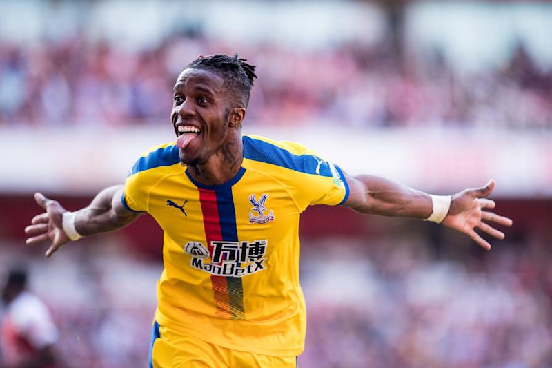 LONDON, ENGLAND - APRIL 21: Wilfried Zaha of Crystal Palace celebrates after scoring a goal during the Premier League match between Arsenal FC and Crystal Palace at Emirates Stadium on April 21, 2019 in London, United Kingdom. (Photo by Sebastian Frej/MB Media/Getty Images)