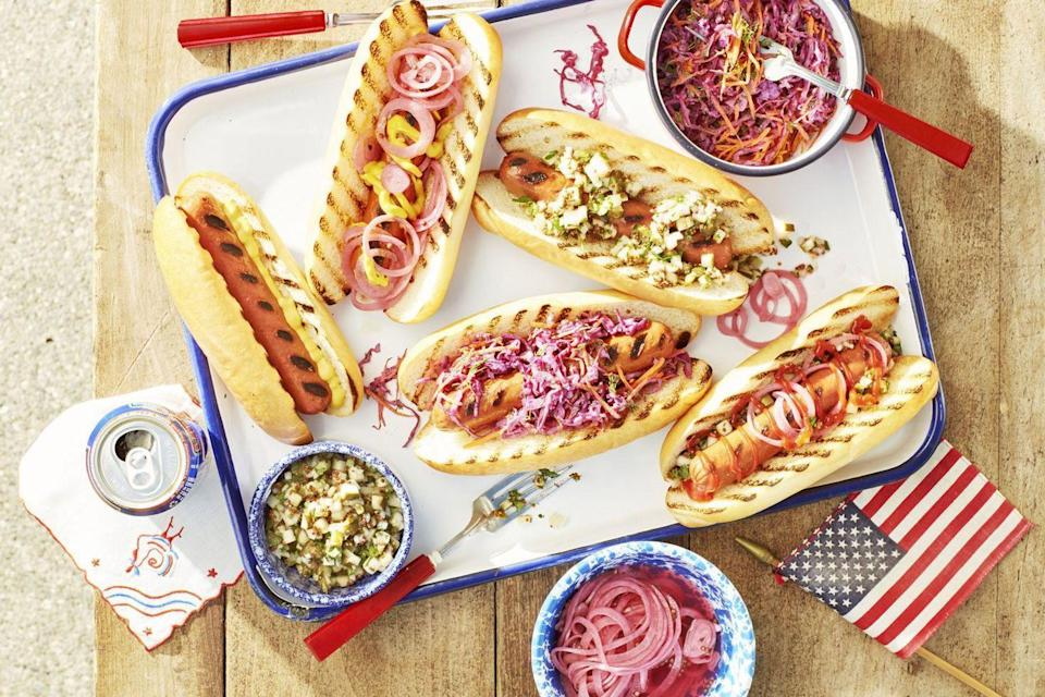 """<p>July 4th is almost upon us! The summer holiday is synonymous with <a href=""""https://www.countryliving.com/food-drinks/g31/best-grilling-recipes/"""" rel=""""nofollow noopener"""" target=""""_blank"""" data-ylk=""""slk:grilling out"""" class=""""link rapid-noclick-resp"""">grilling out</a>, watching <a href=""""https://www.countryliving.com/life/travel/g27819818/where-to-watch-fireworks-near-me/"""" rel=""""nofollow noopener"""" target=""""_blank"""" data-ylk=""""slk:fireworks"""" class=""""link rapid-noclick-resp"""">fireworks</a> and decorating your <a href=""""https://www.countryliving.com/diy-crafts/g3408/4th-of-july-party-ideas/"""" rel=""""nofollow noopener"""" target=""""_blank"""" data-ylk=""""slk:4th of July party"""" class=""""link rapid-noclick-resp"""">4th of July party</a> with plenty of red, white, and blue! From the basics (corn on the cob, coleslaw, and pasta salad) to more out-of-the-box dishes that still feel ultra all-American, we've rounded up some of the best dishes that your celebrations can't do without. <br></p>"""