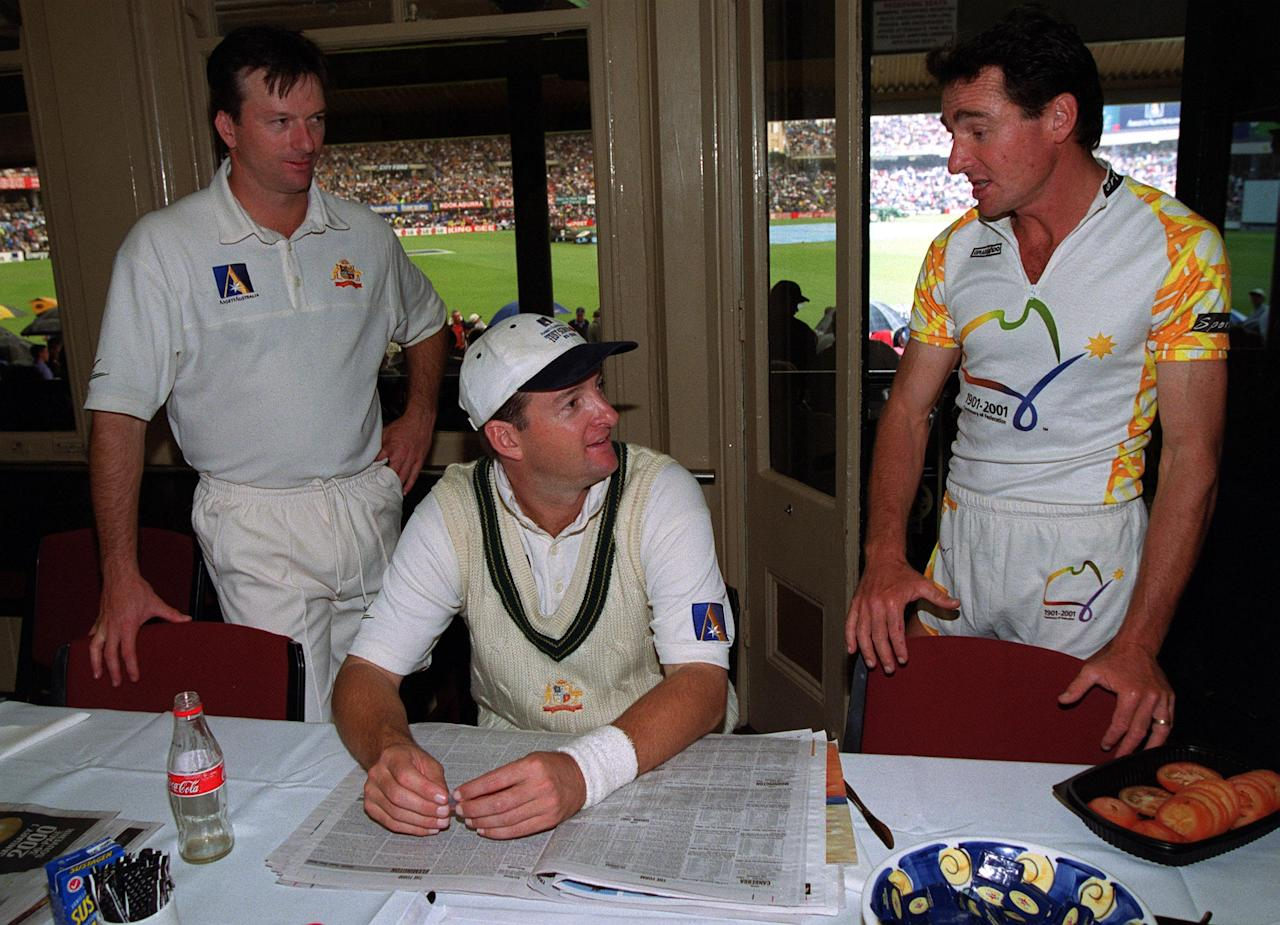 2 Jan 2000: Australia cricket captain Steve Waugh and Mark Waugh appearing in his 100th Test Match talk to Pat Farmer who has recently completed a run around Australia in record time to celebrate a century of Federation for Australia as rain delays the first days play of the Third Test match between Australia and India at the Sydney Cricket Ground, Sydney, Australia. Mandatory Credit: Hamish Blair/ALLSPORT