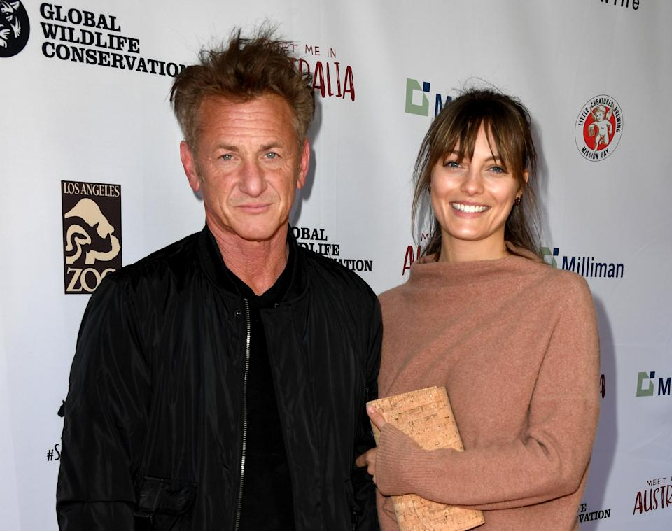 """LOS ANGELES, CALIFORNIA - MARCH 08: Sean Penn (L) and Leila George arrive at the """"Meet Me In Australia"""" event benefiting Australia Wildfire Relief Efforts at Los Angeles Zoo on March 08, 2020 in Los Angeles, California. (Photo by Kevin Winter/Getty Images)"""