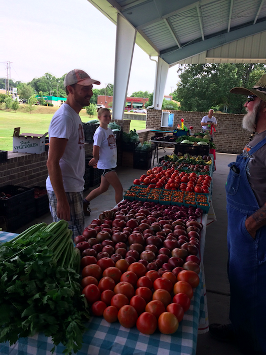 Farmers selling produce at the Market, May 2017