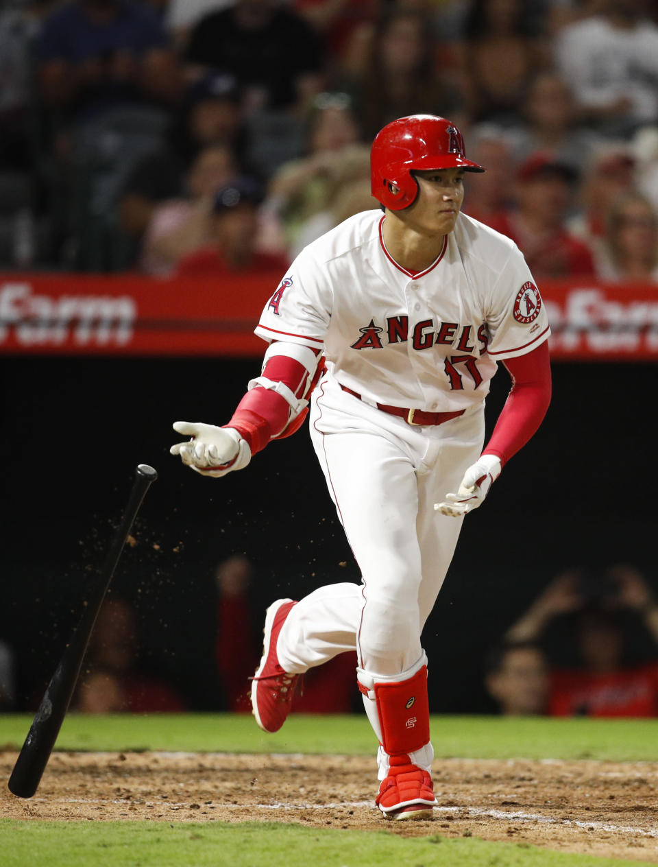 Los Angeles Angels' Shohei Ohtani, of Japan, tosses his bat after hitting a single during the sixth inning of a baseball game against the Seattle Mariners, Saturday, Sept. 15, 2018, in Anaheim, Calif. (AP Photo/Jae C. Hong)
