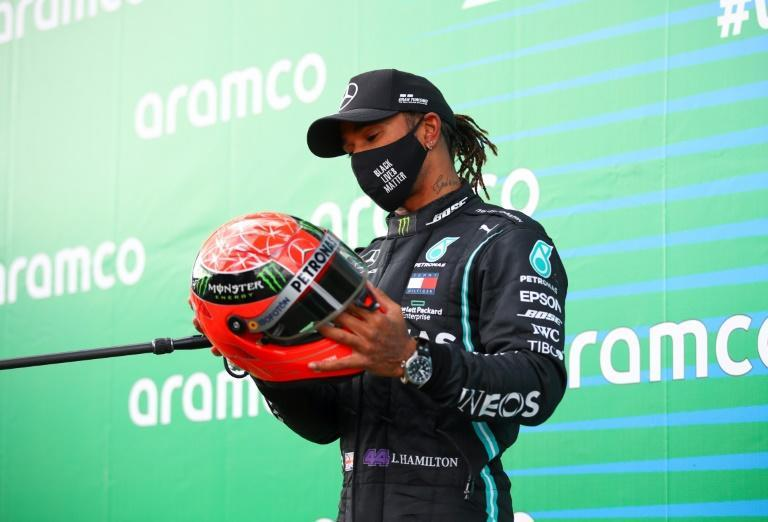 Hamilton, presented with one of Michael Schumacher's helmets at Nurburgring, seeks to claim record outright