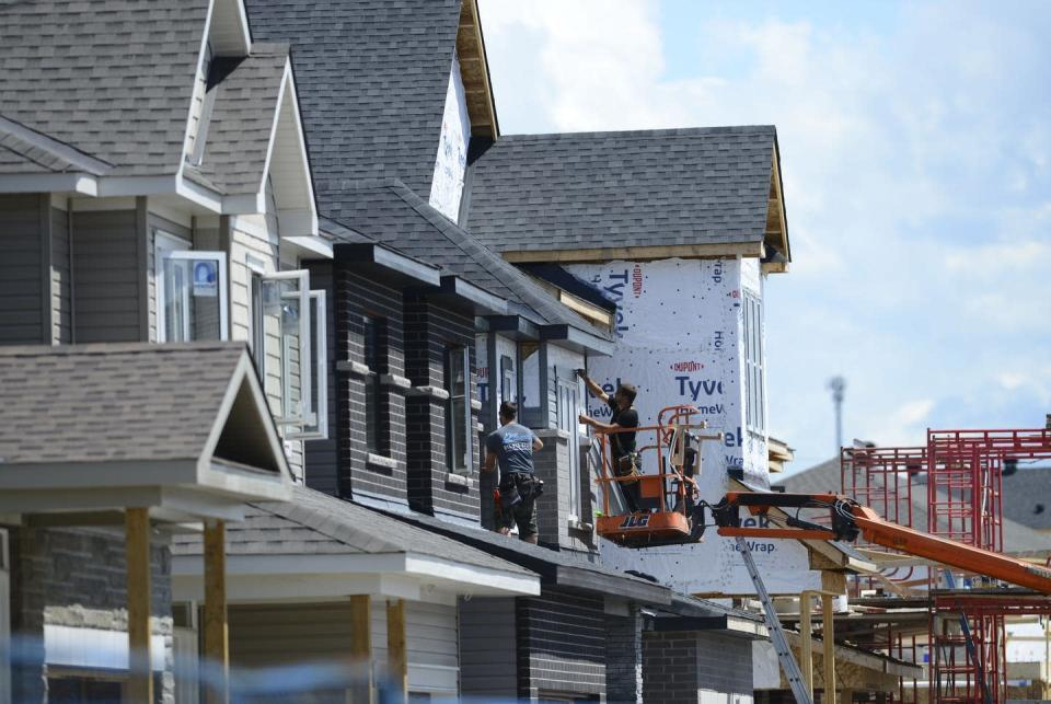 """<span class=""""caption"""">A new home is built in a housing development in Ottawa in July 2020.</span> <span class=""""attribution""""><span class=""""source"""">THE CANADIAN PRESS/Sean Kilpatrick </span></span>"""