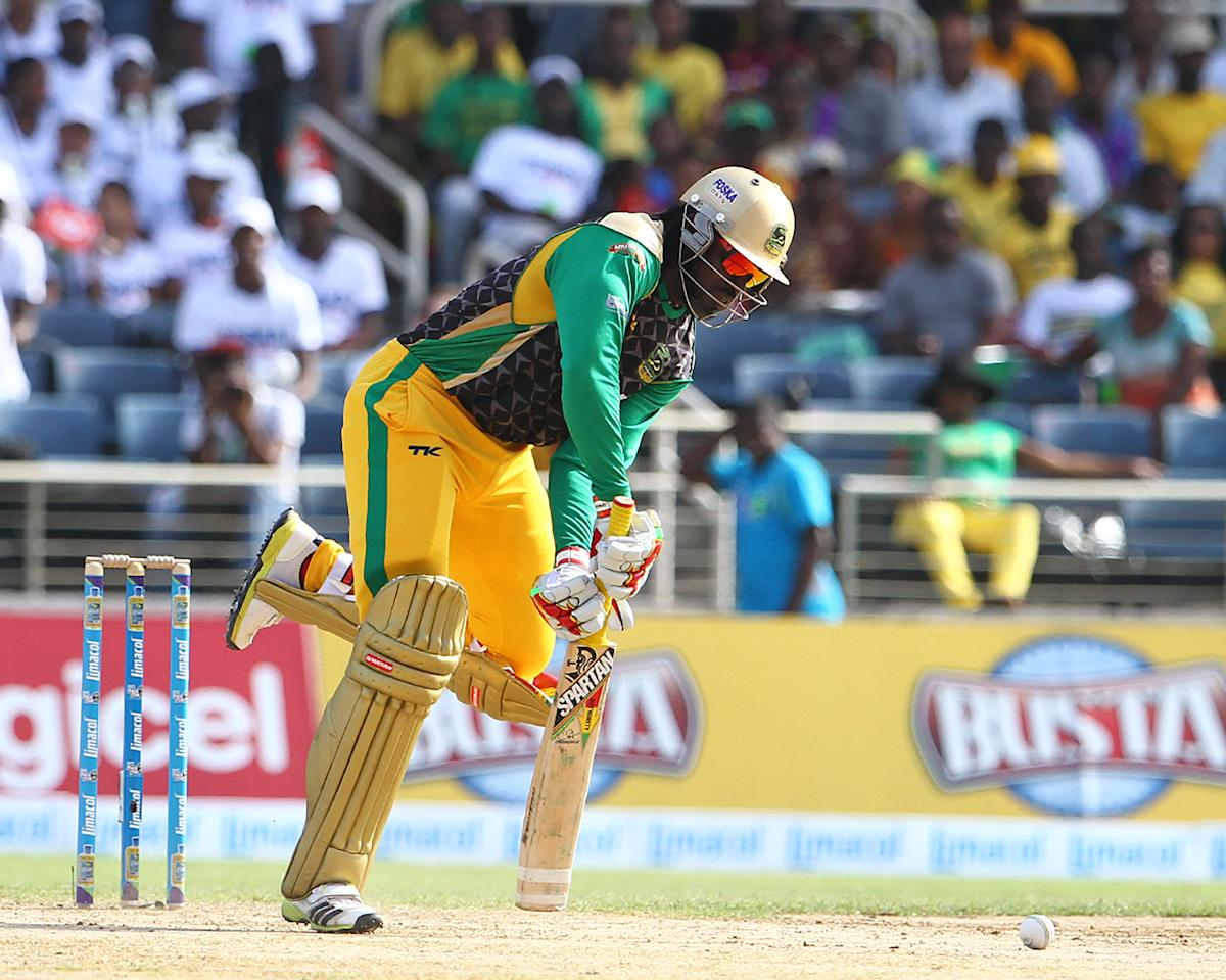 KINGSTON, JAMAICA - AUGUST 15: Jamaica Tallawahs captain Chris Gayle digs out a yorker during the Sixteenth Match of the Cricket Caribbean Premier League between Jamaica Tallawahs v Guyana Amazon Warriors at Sabina Park on August 15, 2013 in Kingston, Jamaica. (Photo by Ashley Allen/Getty Images Latin America for CPL)