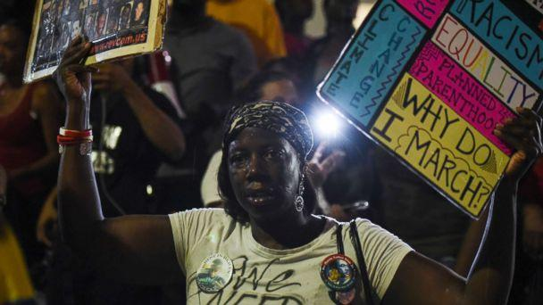 PHOTO: A woman joins demonstrators outside the St. Louis Justice Center following multiple arrests, Sept. 17, protesting the acquittal of former St. Louis police officer Jason Stockley, Sept. 18, 2017, in St. Louis, Mo.  (G-Jun Yam for ABC News)