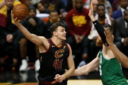 May 19, 2018; Cleveland, OH, USA; Cleveland Cavaliers forward Ante Zizic (41) looks to pass in front of Boston Celtics center Aron Baynes (46) during the second half in game three of the Eastern conference finals of the 2018 NBA Playoffs at Quicken Loans Arena. Mandatory Credit: Aaron Doster-USA TODAY Sports