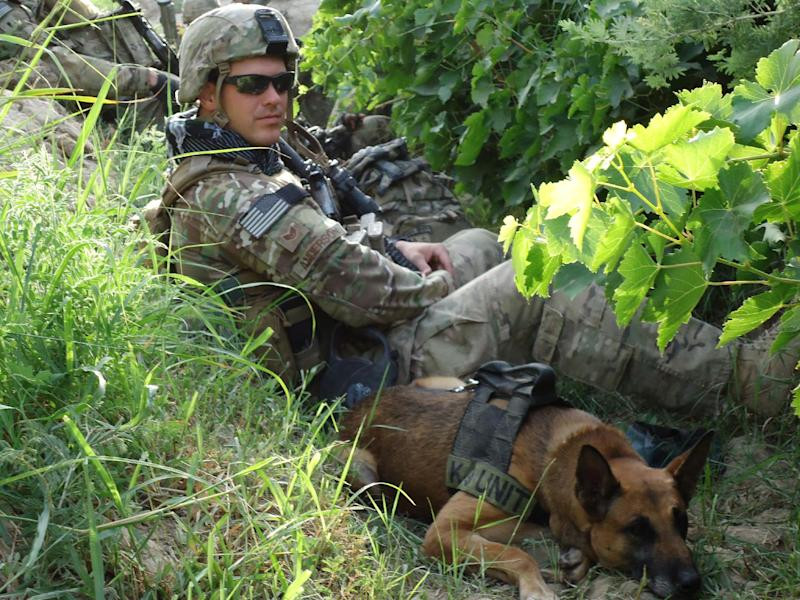 """This 2012 publicity photo provided by Animal Planet shows Air Force Tech. Sgt. Leonard Anderson and a bomb-detecting dog, Azza, an 8-year-old Belgian Malinois, in Afghanistan. Animal Planet television special """"Glory Hounds,"""" included coverage of Air Force Tech. Sgt. Anderson and his team, when they embedded four camera crews with front line troops for six weeks. """"Glory Hounds"""" airs Thursday, Feb. 21, 2013 at 8 p.m. ET/PT and repeats on Feb. 24 at 9 a.m. ET/PT. (AP Photo/Animal Planet)"""