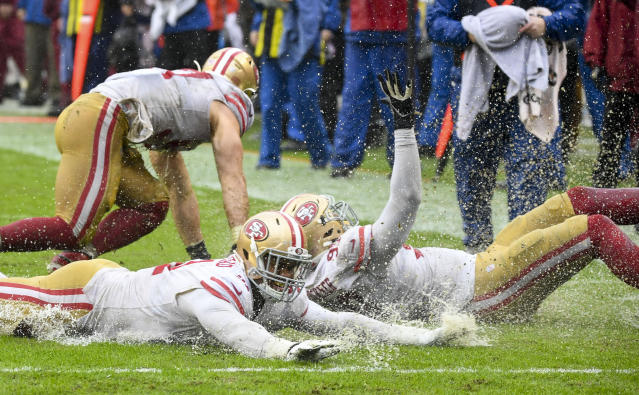 49ers players used the wet field as a Slip-N-Slide to celebrate, but Richard Sherman was just glad he escaped the game without an injury. (Photo by Jonathan Newton / The Washington Post via Getty Images)