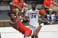 Auburn guard Allen Flanigan (22) saves the ball from going out of bounds in front of Central Florida guard Dre Fuller Jr. (24) during the second half of an NCAA college basketball game, Monday, Nov. 30, 2020, in Orlando, Fla. (AP Photo/John Raoux)