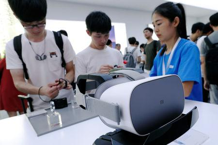FILE PHOTO: A new Xiaomi VR headset is displayed during a product launch in Shenzhen, China May 31, 2018.  REUTERS/Bobby Yip