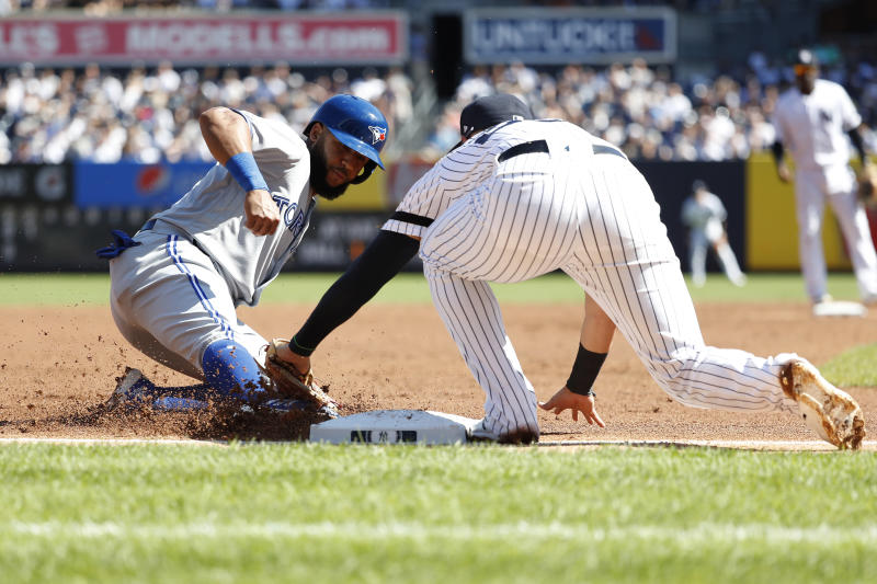 Toronto Blue Jays' Richard Urena is tagged out by New York Yankees third baseman Gio Urshela during the third inning of the team's baseball game, Saturday, Sept. 21, 2019, in New York. (AP Photo/Michael Owens)