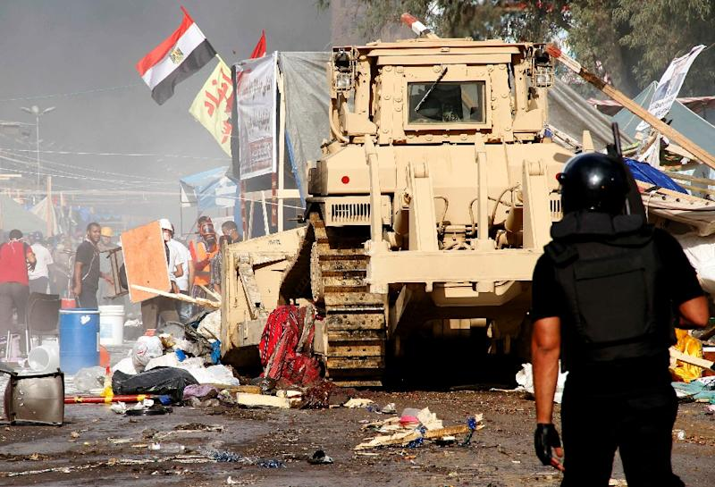 Security forces dismantle a protest camp built by supporters of ousted Egyptian president Mohamed Morsi and members of the Muslim Brotherhood near Cairo's Rabaa al-Adawiya mosque on August 14, 2013