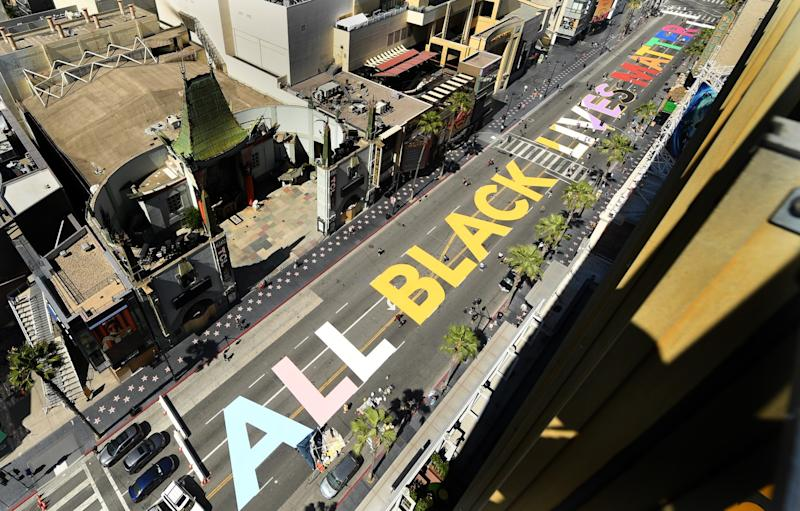 """""""All Black Lives Matter"""" is painted on Hollywood Boulevard in front of the TCL Chinese Theatre."""