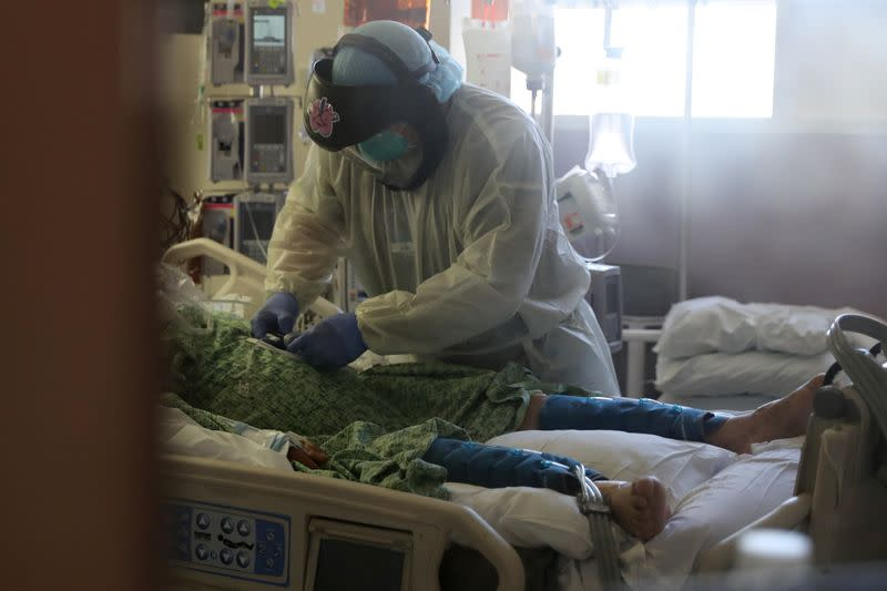 A patient suffering from the coronavirus disease (COVID-19) is treated in the Intensive Care Unit (ICU), at Scripps Mercy Hospital in Chula Vista