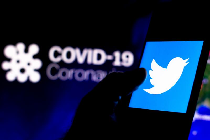 In this photo illustration the Twitter logo seen displayed...