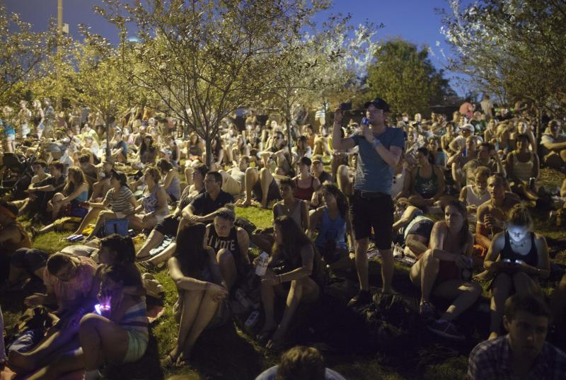 Members of the crowd watch The Black Keys, unseen, play at Lollapalooza in Chicago's Grant Park on Friday, Aug. 3, 2012. (Photo by Sitthixay Ditthavong/Invision/AP)