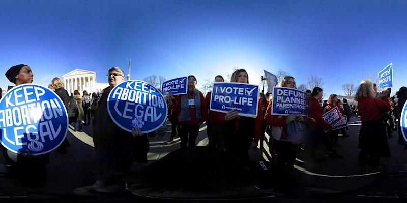 Anti-abortion activists hold signs as they counter-protest in front of the U.S. Supreme Court during the 2018 March for Life January 19 2018 in Washington DC (Alex Wong/Getty)