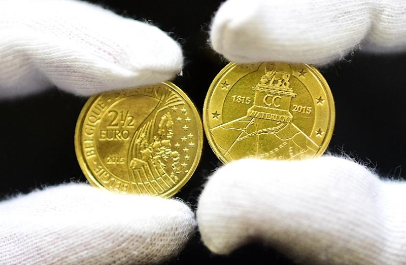 Commemorative coins to mark the 200th anniversary of the Battle of Waterloo are displayed during a ceremony held to unveil the 2.5-euro coin at the Royal Belgium Mint in Brussels on June 8, 2015