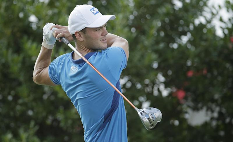 Martin Kaymer, of Germany, watches his tee shot on the 14th hole during the first round of the U.S. Open golf tournament in Pinehurst, N.C., Thursday, June 12, 2014. (AP Photo/Charlie Riedel)