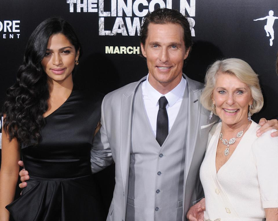 """HOLLYWOOD, CA - MARCH 10: Camila Alves, Matthew McConaughey and mom Mary Kathleen McCabe arrive at the Los Angeles Premiere of """"The Lincoln Lawyer"""" at the ArcLight Hollywood on March 10, 2011 in Hollywood, California.  (Photo by Gregg DeGuire/FilmMagic)"""