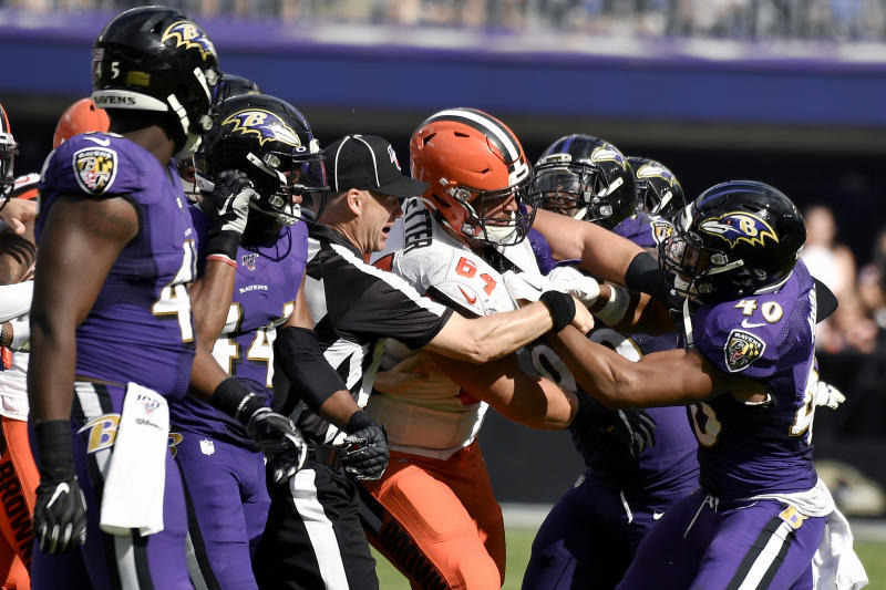 Cleveland Browns center JC Tretter (64) scuffles with Baltimore Ravens inside linebacker Kenny Young (40) during the second half of an NFL football game Sunday, Sept. 29, 2019, in Baltimore. (AP Photo/Brien Aho)