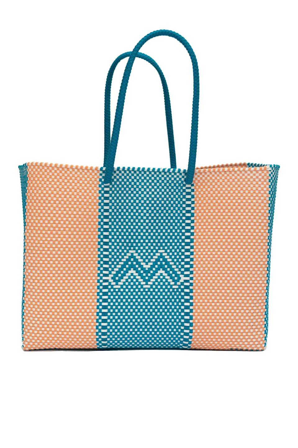 """<p><strong>Modulare</strong></p><p>modulare.us</p><p><strong>$148.00</strong></p><p><a href=""""https://modulare.us/products/sorbet-woven-tote-bag?_pos=1&_sid=2ea74d308&_ss=r"""" rel=""""nofollow noopener"""" target=""""_blank"""" data-ylk=""""slk:Shop Now"""" class=""""link rapid-noclick-resp"""">Shop Now</a></p><p>Launched in March 2020, Maison Modulare was founded by Chrys Wong, who discovered success by creating luxury masks using fabric surplus in response to the global pandemic. Wong's brand reflects her zero-waste policy and consists of pieces made by family-owned operations across the world, including Oaxaca, Mexico, where this hand-crafted weaved tote was made from 100% recyclable vinyl. This sturdy, colorful tote is perfect for running errands, going to the beach or grabbing produce at the local farmer's market.</p>"""