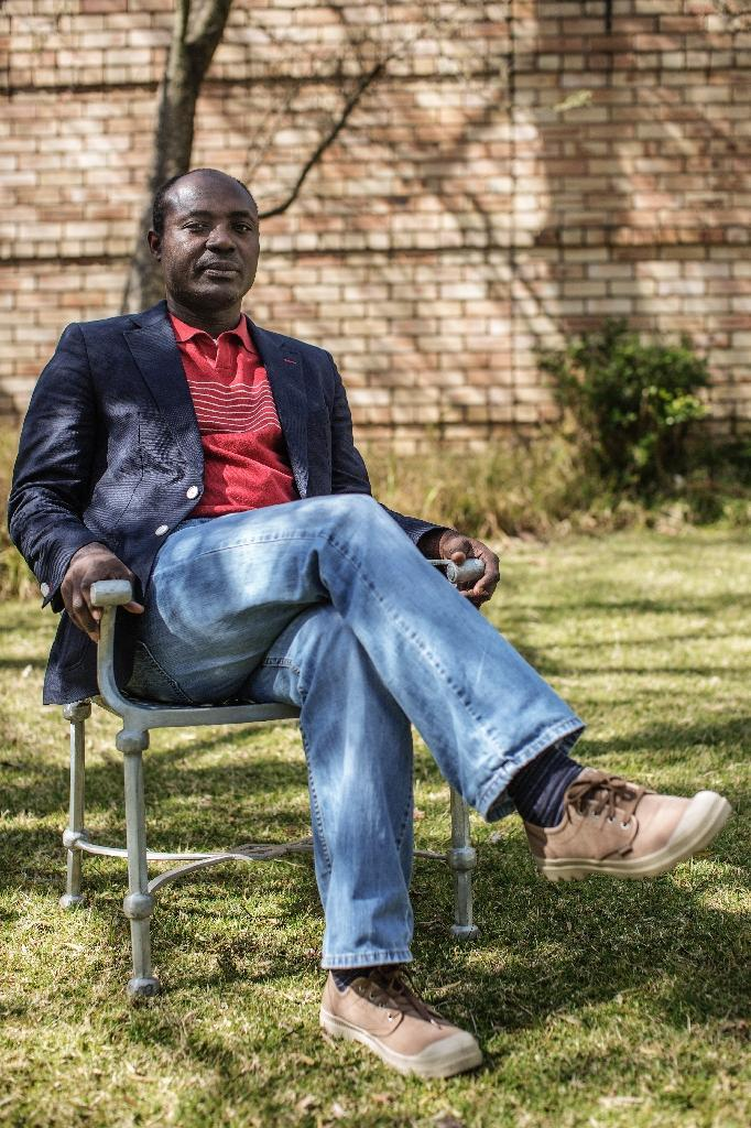 Angolan journalist and human rights activist Rafael Marques de Morais poses during an interview on August 14, 2015 in Johannesburg, South Africa (AFP Photo/Gianluigi Guercia)