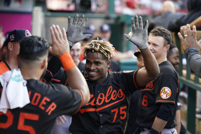 Baltimore Orioles' Domingo Leyba (75) celebrates in the dugout with teammates after hitting a home run during the second inning of a baseball game against the Los Angeles Angels Friday, July 2, 2021, in Anaheim. (AP Photo/Ashley Landis)
