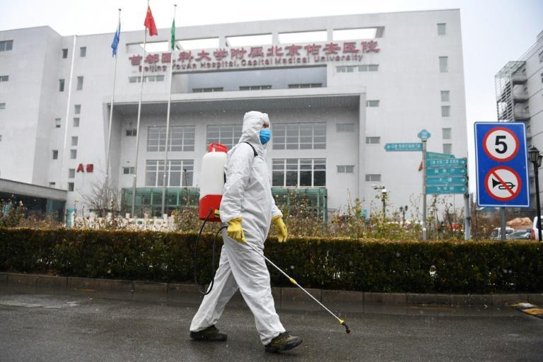 The epidemic has continued to spread across China and hundreds of cases have emerged in more than two dozen countries (AFP Photo/GREG BAKER)