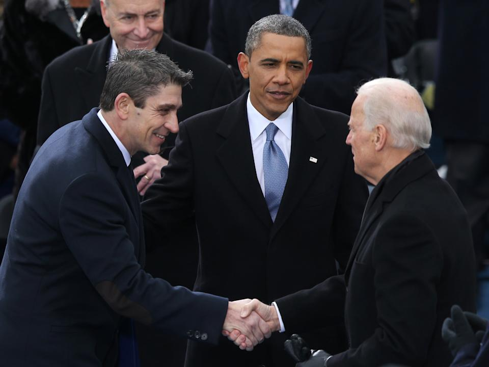 Richard blanco is greeted by then-Vice President Joe Biden and then-President Barack Obama after reciting his poem during the presidential inauguration on 21 January 2013 at the US Capitol in Washington, DC (Mark Wilson/Getty Images)