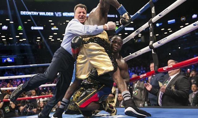 """<span class=""""element-image__caption"""">The referee pulls Deontay Wilder away from Bermane Stiverne after the American knocked out the Haitian-Canadian.</span> <span class=""""element-image__credit"""">Photograph: Kevin Hagen/AP</span>"""