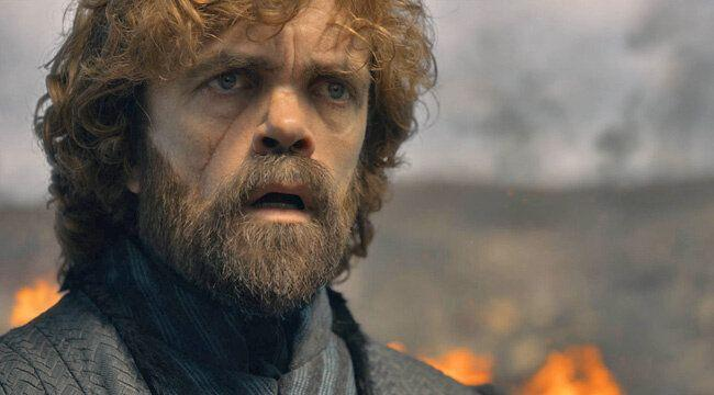 Tyrion Lannister (Robert Dinklage) looks on in shock as land burns behind him.