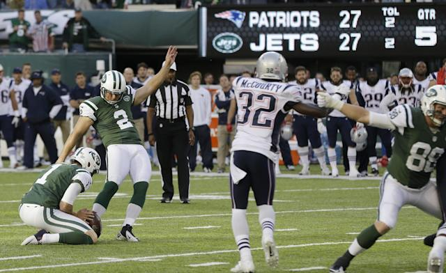 New York Jets kicker Nick Folk (2) kicks a field goal to win the game during overtime of an NFL football game against the New England Patriots Sunday, Oct. 20, 2013 in East Rutherford, N.J. The Jets won the game 30-27. The Patriots' Devin McCourty (32) is at center. (AP Photo/Seth Wenig)