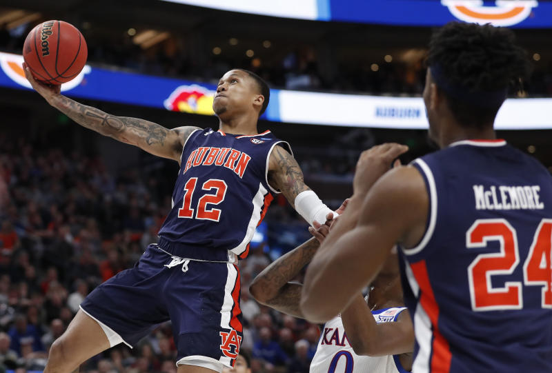 NCAA Latest: Auburn trounces Kansas to reach Sweet 16