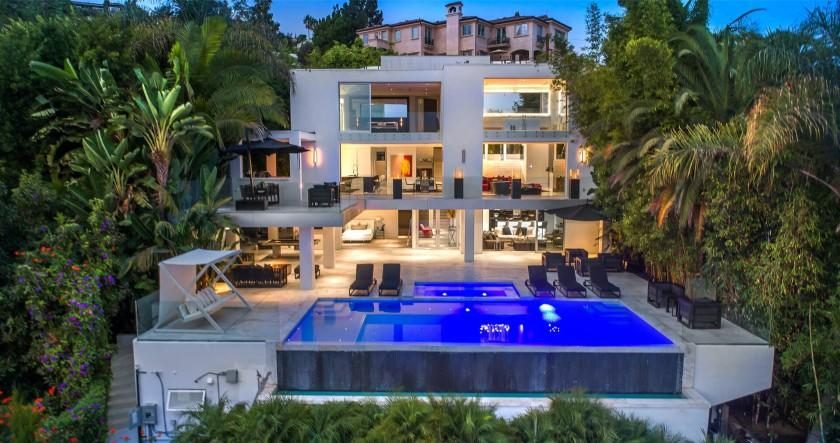 Outfitted with flashy style and high-end amenities, the three-story home holds three bedrooms and six bathrooms in 6,000 square feet.