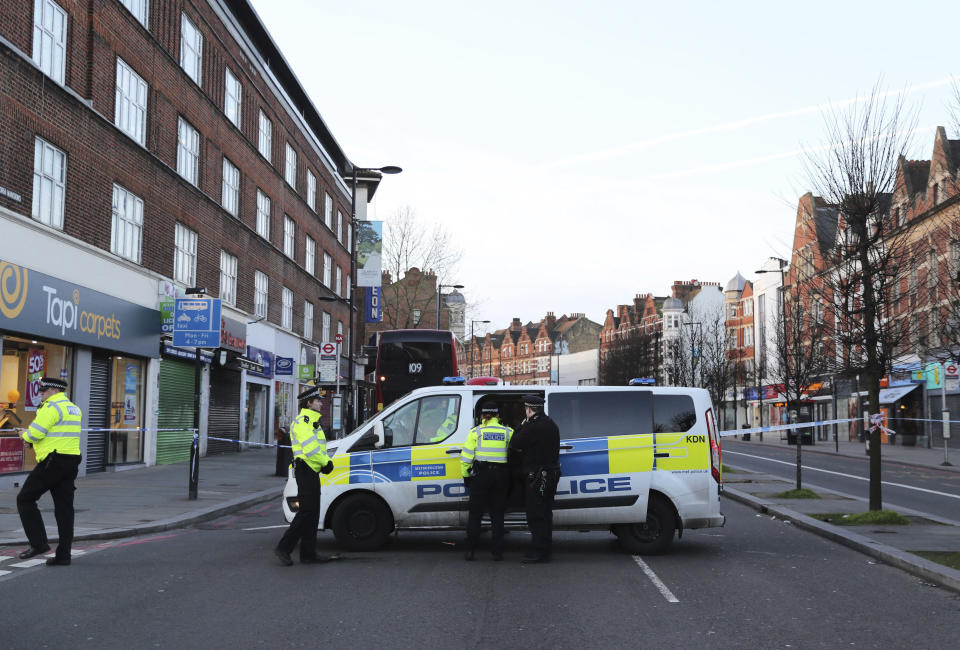 Police continue to secure the scene following a terror stabbing attack in the Streatham area of south London Monday Feb. 3, 2020. Police in London say the man identified as 20-year-old Sudesh Amman was wearing a fake bomb and stabbed two people Sunday before being shot to death by police was recently released from prison, where he was serving for terrorism offenses.(Aaron Chown/PA via AP)