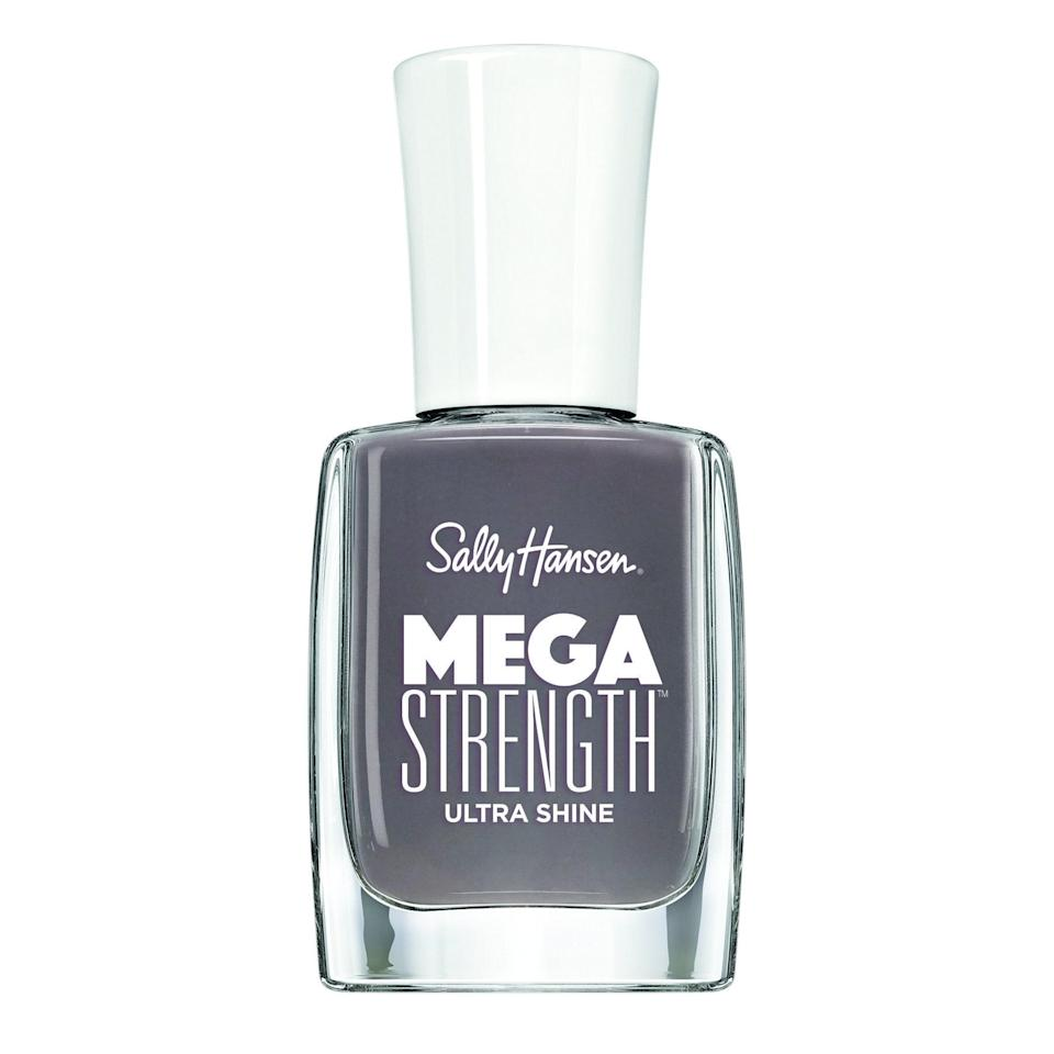 """<p>There's a darker smokiness that makes Sally Hansen's Mega Strength Ultra Shine Nail Polish in Here to Stay both edgy and neutral at the same time. It's just dark enough to get noticed, and just subtle enough to go with any outfit imaginable in your fall fashion lineup.</p> <p><strong>$2</strong> (<a href=""""https://shop-links.co/1681832880470995838"""" rel=""""nofollow noopener"""" target=""""_blank"""" data-ylk=""""slk:Shop Now"""" class=""""link rapid-noclick-resp"""">Shop Now</a>)</p>"""