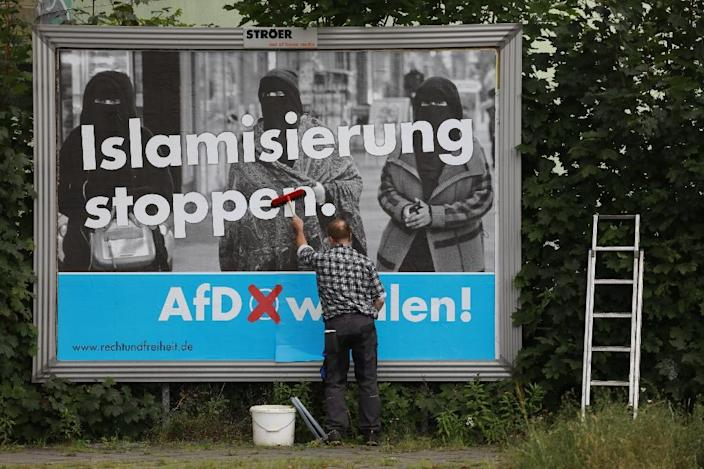 """An AfD poster reads """"Stop Islamisation"""" (AFP Photo/Odd ANDERSEN)"""