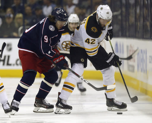 Columbus Blue Jackets forward Artemi Panarin, left, of Russia, works against Boston Bruins forward David Backes during the first period of Game 4 of an NHL hockey second-round playoff series in Columbus, Ohio, Thursday, May 2, 2019. (AP Photo/Paul Vernon)